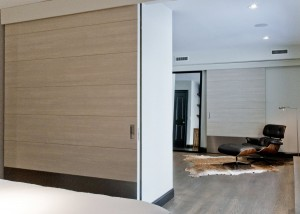 Matching white oak large sliding doors both doors foreground backgroud